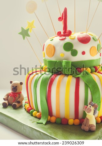 Details of birthday cake, colorful decoration and number one on top. - stock photo