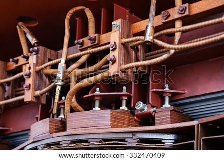 details of broken high voltage power transformer at repair shop - stock photo