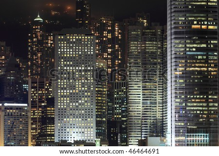 Details of business buildings at night in Hong Kong - stock photo