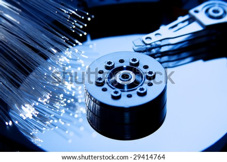 Details of computer hard drive with optic fiber - stock photo