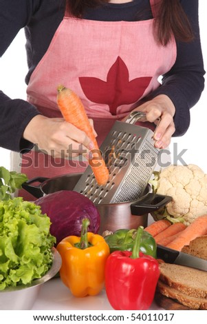 details of cutting carrot with stainless grater - stock photo