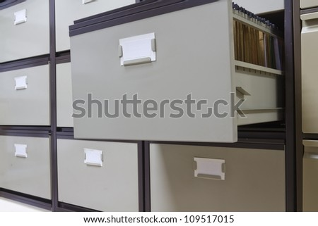 Details of each open file cabinets in an office - stock photo