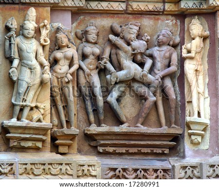 Details of erotic sculpture in one of the temples of Khajuraho, India