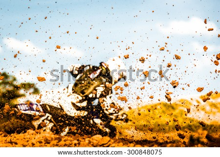 Details of flying debris during a motocross race - stock photo
