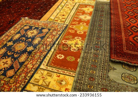 Details of hand woven carpets  in rug store  Ephesus, Turkey - stock photo