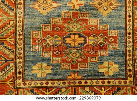 Details of intricate blue patterns in Turkish carpets  in rug store  inGoreme, Cappadocia, Turkey  - stock photo