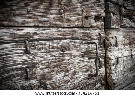 Details of iron and rust on an old wooden door - stock photo