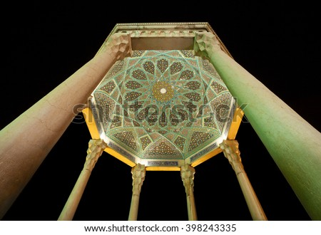 Details of Islamic design inside dome of Hafez mausoleum, the Great Iranian Poet, captured in Shiraz at night. - stock photo