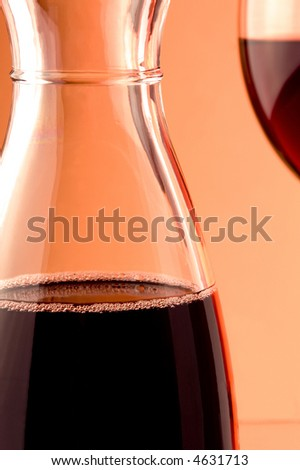 details of jug and glass of red wine