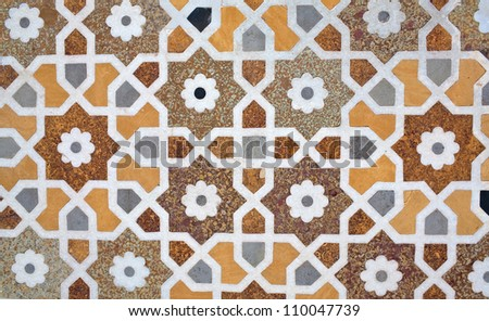 Details of marble surface with stone inlay in Agra, India.