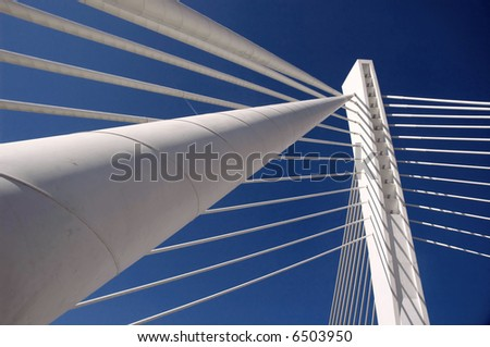 Details of modern bridge vith long holding cables. - stock photo