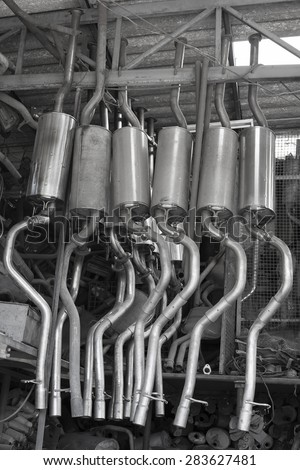 Details of new automotive exhaust system stainless steel. - stock photo