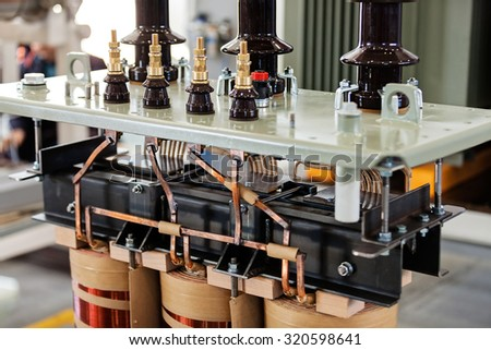details of new high voltage power transformer in factory - stock photo