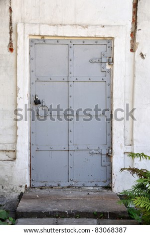 Details of old fashioned door in building. - stock photo