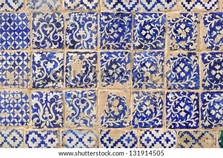 Details of old weathered tiles texture on muslim tomb in Kashgar - stock photo