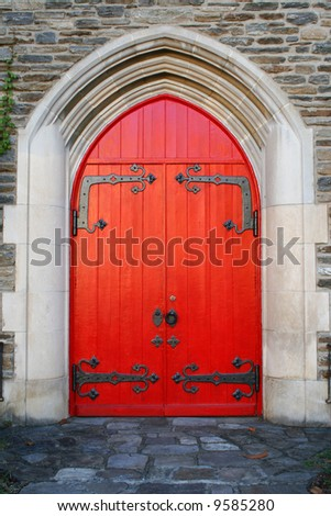 Details of Red Door and  arch on rock building - stock photo