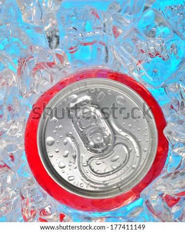 Details of Soda can in ice and drops - stock photo