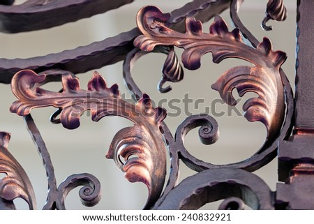 details of structure and ornaments of wrought iron fence and gate - stock photo