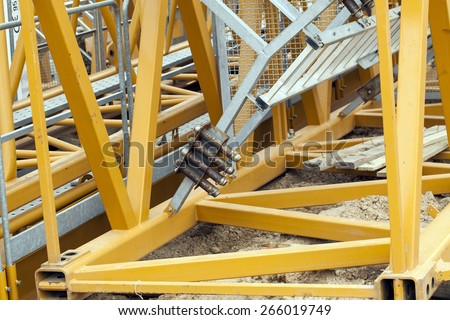 details of structure of high-rise construction crane yellow.