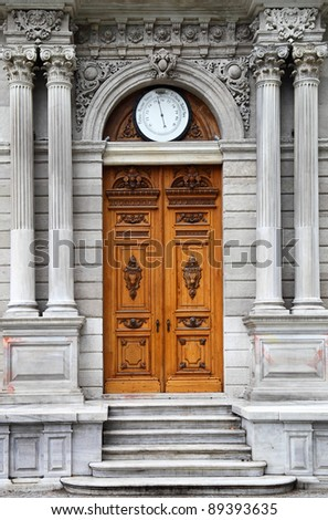 Details of the baroque style architecture at the Dolmabahce Palace Clock- tower. The Barometer above the door indicates the air pressure. - stock photo