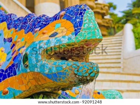 Details of the ceramic dragon fountain at Parc Guell designed by Antoni Gaudi, Barcelona, Spain. - stock photo