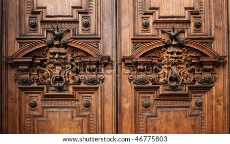 Details of the door of an ancient rich palace - stock photo
