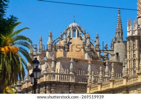 Details of the facade of the cathedral of Santa Maria La Giralda in Seville, Spain - stock photo
