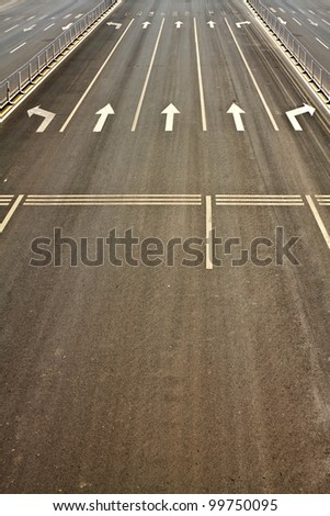Details of wide street roads with traffic symbols - stock photo