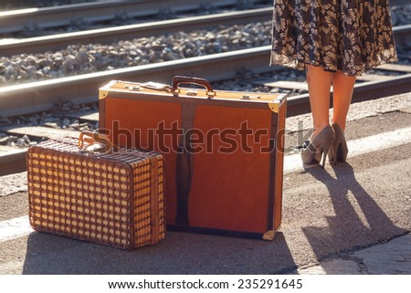 Details of woman waiting at the railway station - stock photo