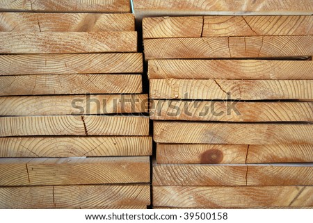 Details of wooden boards stacked and viewed from the end
