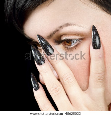 Details of young beautiful woman. Nail design and eye with long eyelashes. - stock photo