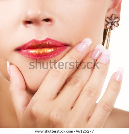Details of young beautiful woman. Nail design and lips with makeup.