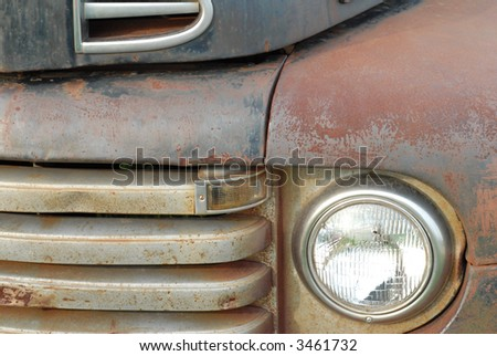 details on the front of a rusted old pick up truck - stock photo