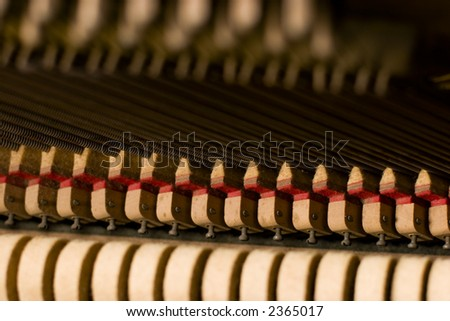 Details on the inside of an old antique piano - stock photo