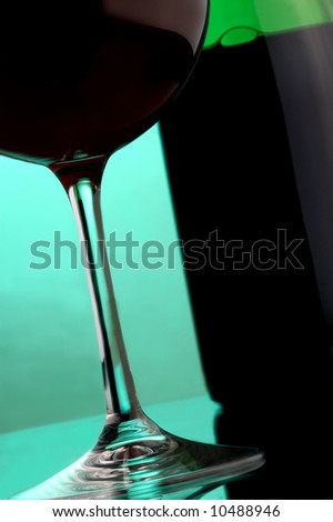 details red wine a glass and a bottle
