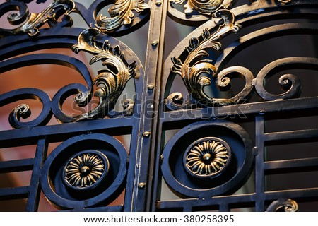 Details, structure and ornaments of wrought iron fence with gate - stock photo