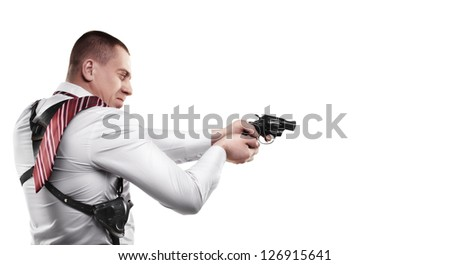 detective holding gun (revolver) ready to shoot isolated on white background High resolution - stock photo