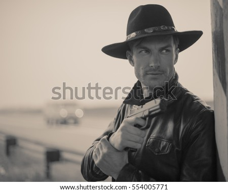 detective with a gun in his hand watching