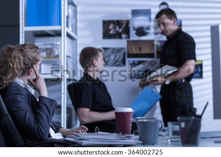 Detectives working in private agency and conducting an investigation - stock photo