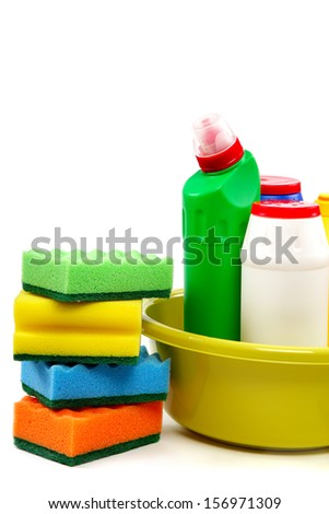 Detergent bottles and cleaning sponge on a white background.