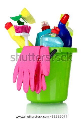 detergent bottles, brushes and gloves in bucket isolated on white