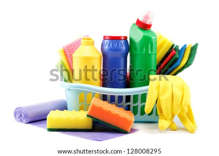 Detergent bottles, rubber gloves and cleaning sponge on a white background. - stock photo