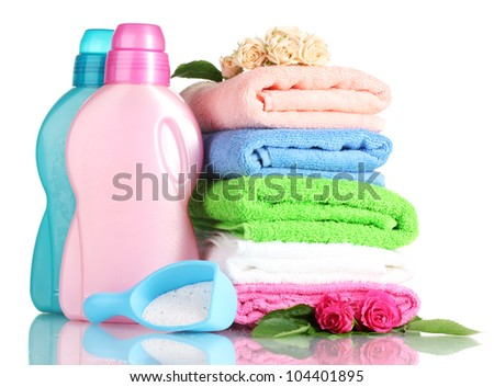 Detergent with washing powder and towels isolated on white - stock photo