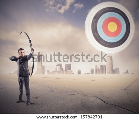 Determinated businessman and Hit the target concept - stock photo