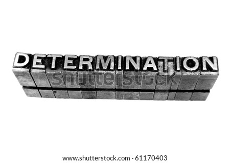 DETERMINATION written in metallic letters on a white background - stock photo