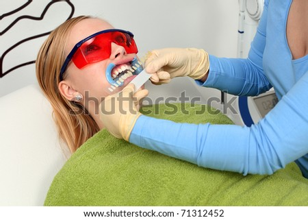 Determine the hue of teeth. - stock photo