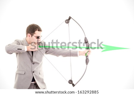 Determined businessman aiming at target, bow and arrow - stock photo
