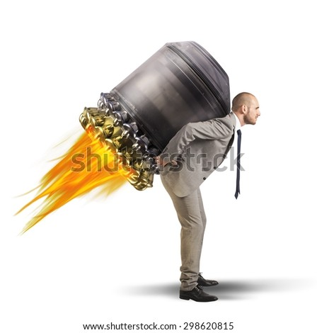 Determined businessman holding on to a spaceship - stock photo