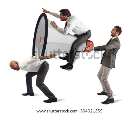 Determined businessmen holding up a big megaphone