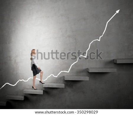 determined businesswoman in the spotlight climbing a carrer ladder, positive trend at the back, dark background, concept of success and career growth - stock photo